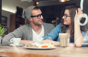 Young couple spending time together in restaurant