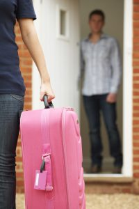 Woman With Packed Suitcase Leaving Husband
